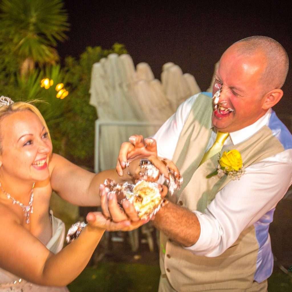 Couple having fun with their cake